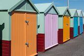 Row Of Beach Huts In Sunshine