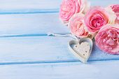 image of life event  - Background with fresh roses and decorative heart on blue table - JPG