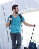 Young Traveling Man Standing Outside With Bag