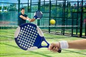 Men Playing Paddle Tennis
