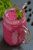 Blueberry smoothie in a glass jar