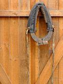 Horse collar hanging on a wooden door.