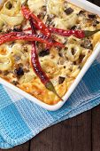 Moussaka dish with aubergine and chili pepper, traditional greek meal