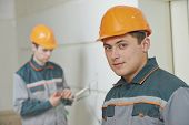 portrait of electricians. one worker worker in uniform working with cable wiring