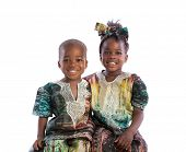 Smiling Young African American Brother and Sister Portrait Isolated on White Background Wearing Colo