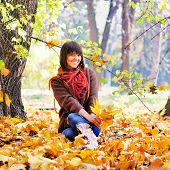 Happy young woman rest on the nature, autumn outdoor.