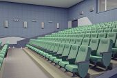 empty green armchairs in modern theater Hall.3d concept