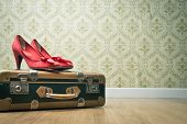 Vintage Suitcase And Red Shoes