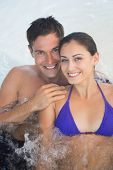 Close up portrait of a smiling young couple in swimming pool