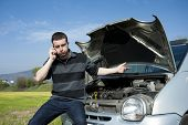 stock photo of towing  - sad man calling the tow truck for car service - JPG