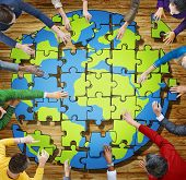People with Jigsaw Puzzle Forming Globe in Photo and Illustration