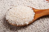 Rice and wooden spoon.