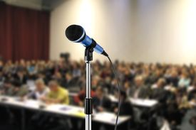 picture of seminar  - image of microphone during seminar in a hall - JPG