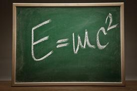 stock photo of einstein  - Albert Einsteins physical formula on green blackboard - JPG