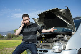picture of towing  - sad man calling the tow truck for car service - JPG