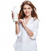 Wellness beauty woman holding a bottle of milk in her hand