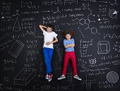 Two schoolkids learning