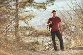 Hiker Man Walking In Forest