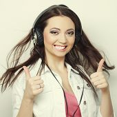 young expression woman over gray background, happy time