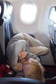 Young woman sleeping on airplane