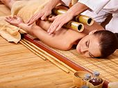 pic of therapist massage  - Young woman getting bamboo massage - JPG