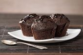 Spongecake Or Muffin With Chocolate Sauce