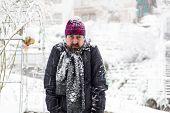 Grumpy Man In A Snowy Garden