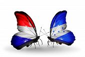 Two Butterflies With Flags On Wings As Symbol Of Relations Holland And Honduras