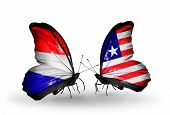 Two Butterflies With Flags On Wings As Symbol Of Relations Holland And  Liberia