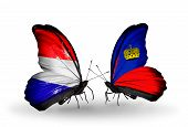 Two Butterflies With Flags On Wings As Symbol Of Relations Holland And Liechtenstein