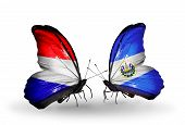 Two Butterflies With Flags On Wings As Symbol Of Relations Holland And Salvador