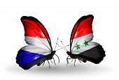 stock photo of holland flag  - Two butterflies with flags on wings as symbol of relations Holland and Syria - JPG