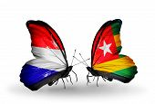 Two Butterflies With Flags On Wings As Symbol Of Relations Holland And Togo