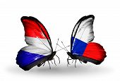 foto of holland flag  - Two butterflies with flags on wings as symbol of relations Holland and Czech - JPG