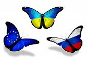 Three Butterflies With Flags On Wings As Symbol Of Relations Russia, European Union And Ukraine