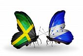 Two Butterflies With Flags On Wings As Symbol Of Relations Jamaica And Honduras