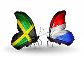 Two Butterflies With Flags On Wings As Symbol Of Relations Jamaica And Luxembourg