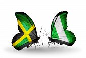 Two Butterflies With Flags On Wings As Symbol Of Relations Jamaica And Nigeria