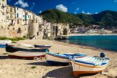 image of old boat  - wooden fishing boats on the old beach of Cefalu Sicily - JPG