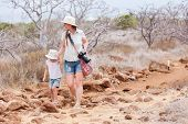 Mother and daughter hiking at North Seymour, Galapagos islands, Ecuador