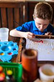 pic of batik  - Cute little boy painting a batik - JPG
