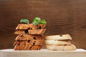 Italian Biscotti In Two Piles With Fresh Mint