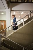 Businessman going down the stairs in office building