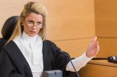 stock photo of court room  - Stern judge speaking to the court in the court room - JPG