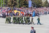 Russian Soldiers March At The Parade On Annual Victory Day