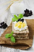 pic of mountain-ash  - rye bread with cottage cheese mango and berries of mountain ash on a white wooden background - JPG