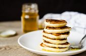 Hot Pancake With Honey On White Plate