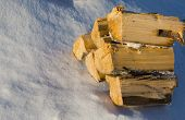 Firewood Lying On The White Snow