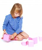 stock photo of inflatable slide  - Girl playing with blocks on a white background - JPG