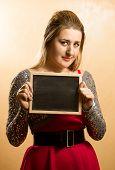 Shy Woman Posing With Empty Blackboard